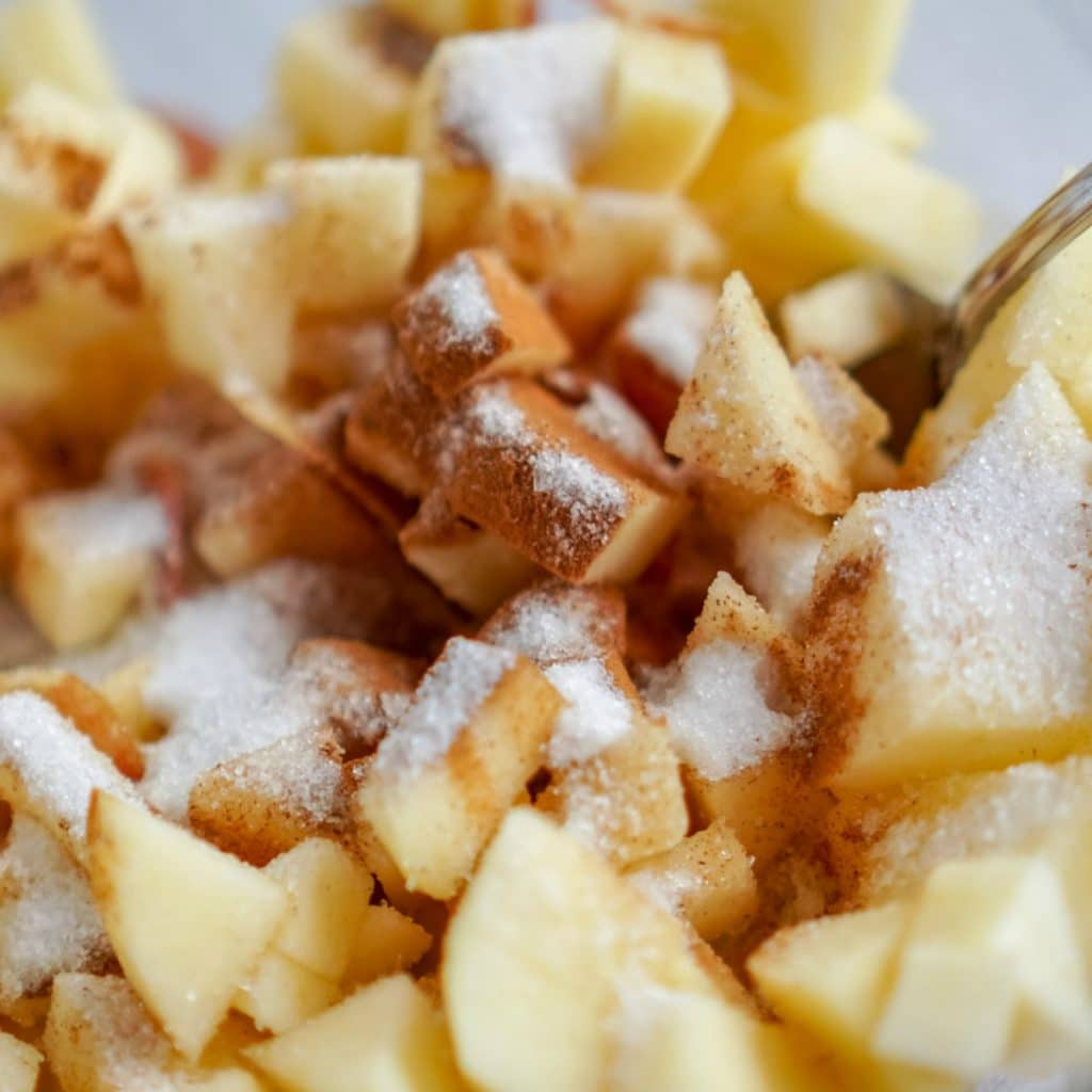 apples with cinnamon and sugar in a bowl