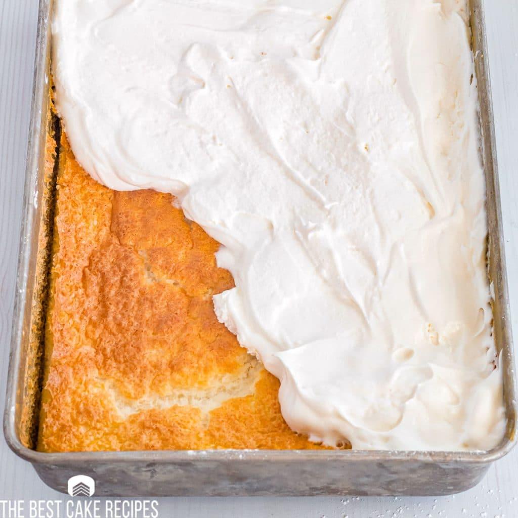 half frosted Pineapple Orange Angel Food Cake