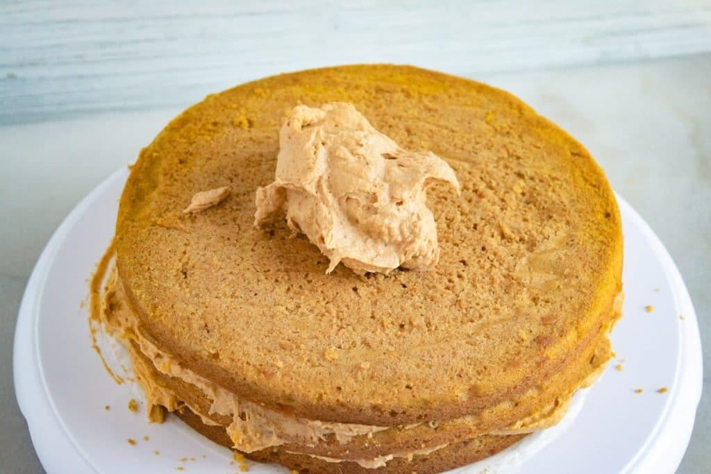 dollop of pumpkin ganache on a pumpkin cake