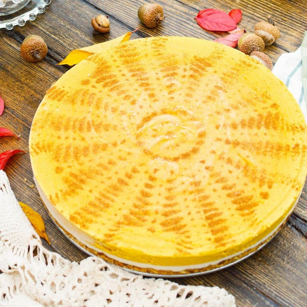 Vegan Pumpkin Pie with doily pattern