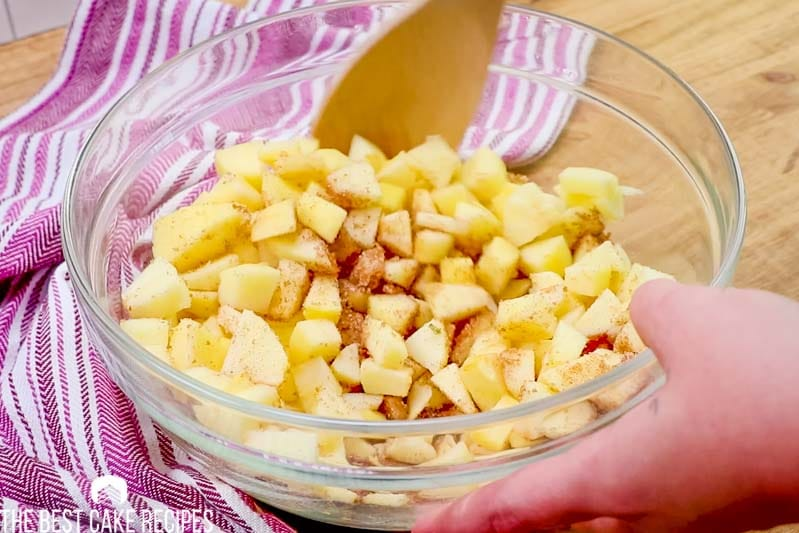 cinnamon sugar apples in a mixing bowl