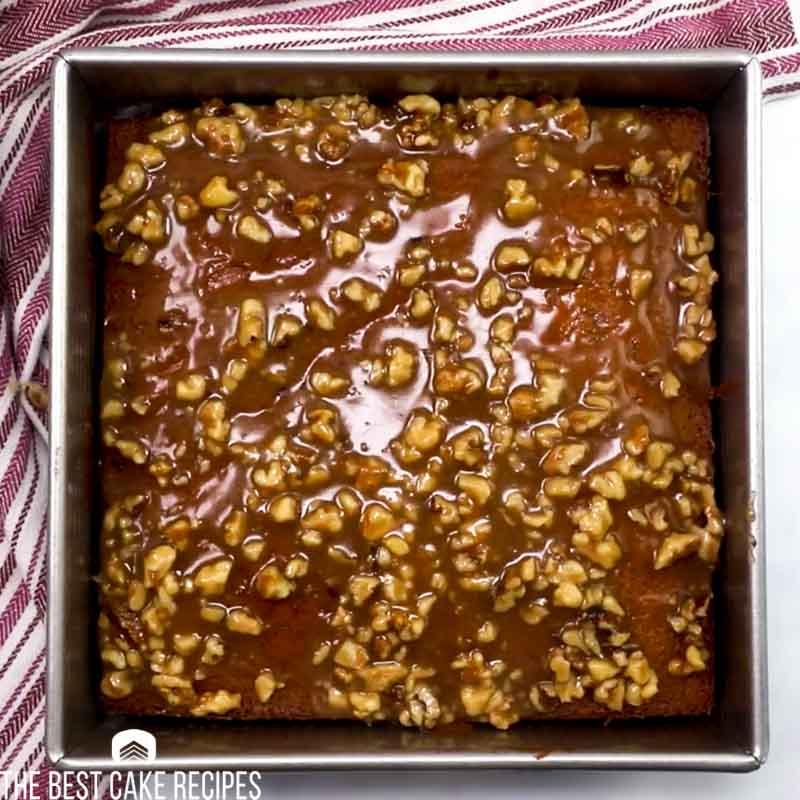 overhead view of date walnut cake with glaze