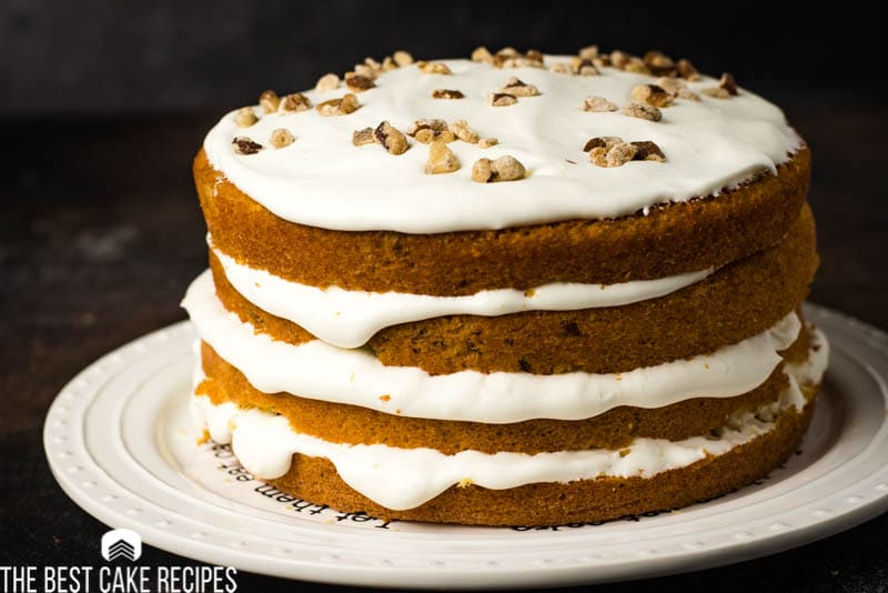 4 layer yellow cake with white frosting and walnuts
