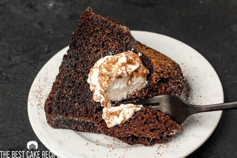 chocolate cake with whipped cream on a plate