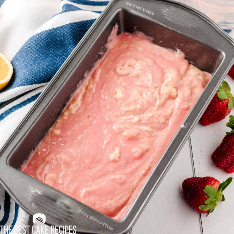 strawberry cake batter in pan