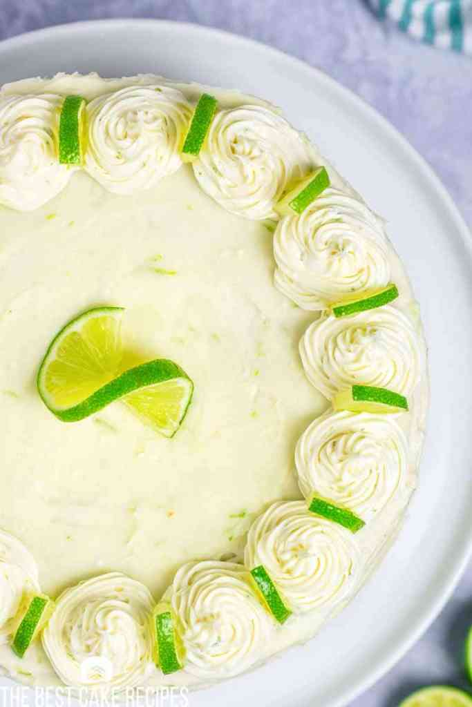 Homemade cake full of sweet & tangy key lime flavor. This 100% from scratch Key Lime Cake with homemade buttercream brings summer days close.