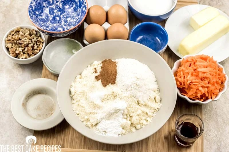 ingredients for carrot cake in a bowl