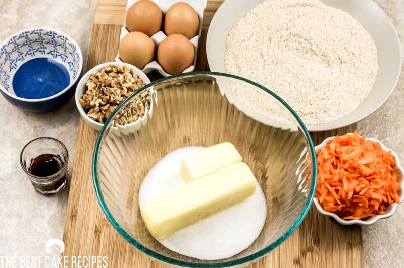 carrot cake ingredients - butter and sugar in a bowl