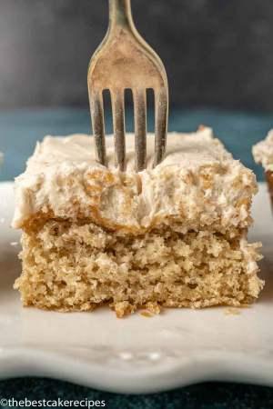 fork cutting into buttermilk cake