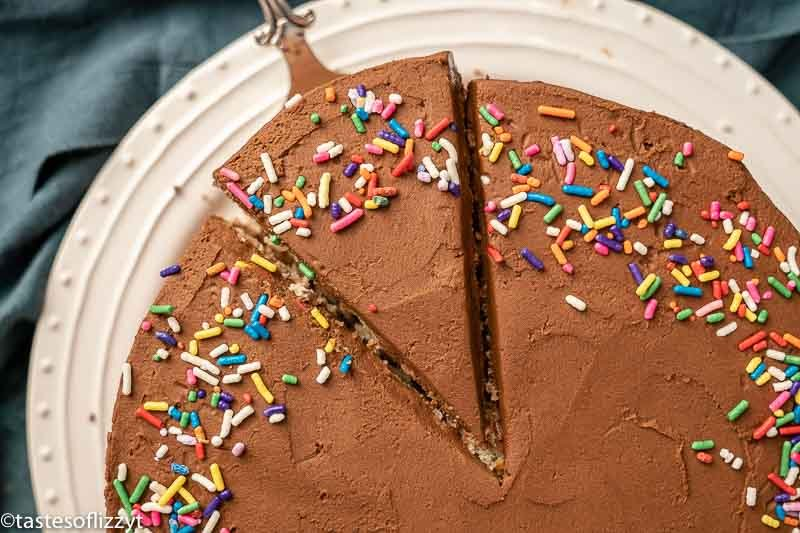cake with chocolate frosting with one slice cut