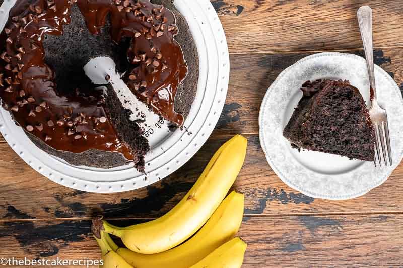 chocolate banana cake with one slice on a plate