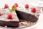 chocolate cake with raspberries on top