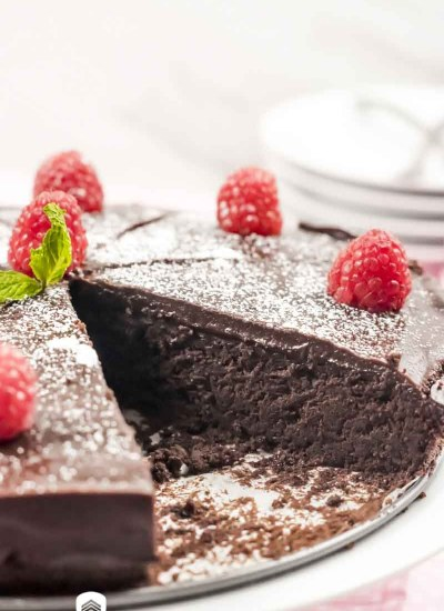 keto chocolate fudge cake with a slice missing