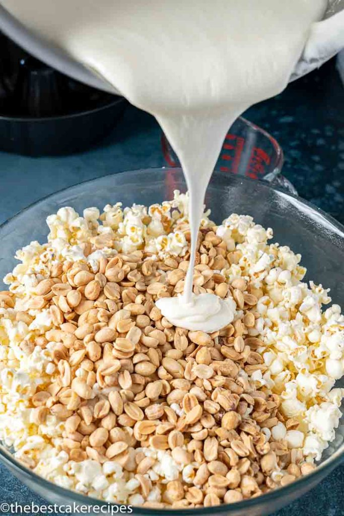 marshmallow pouring over peanuts and popcorn