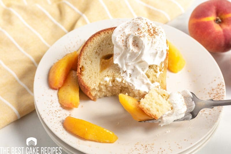 slice of peach pound cake with a bite on a fork
