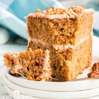 slice of apple butter layer cake with a bite out of it