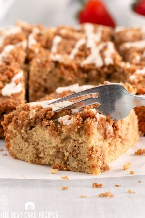 slice of graham cracker coffee cake with a fork