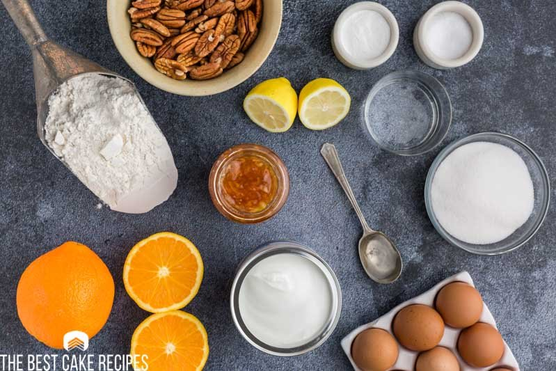 ingredients for orange marmalade cake on a table