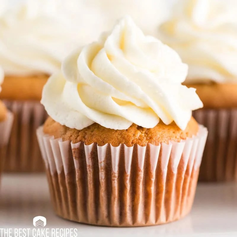 spiced cupcake with lemon buttercream on a table