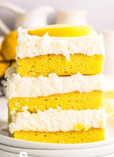stack of 3 lemon cookie bars with frosting