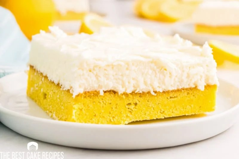 cream cheese frosted lemon bar on a plate