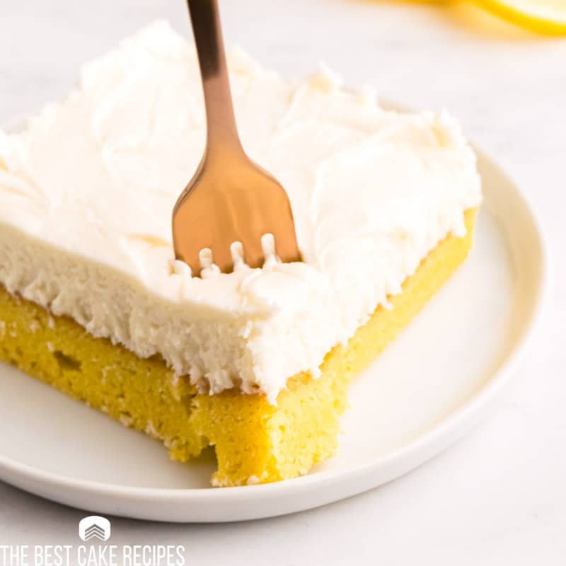 closeup of a frosted lemon brownie with a fork
