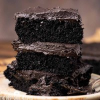 stack of 3 pieces of chocolate cake