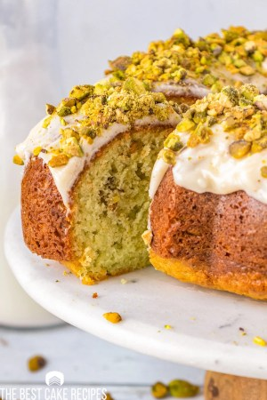 pistachio bundt cake with a slice cut