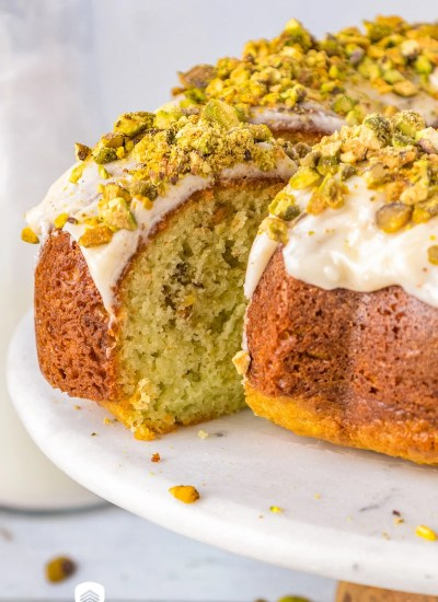pistachio bundt cake with a slice cut