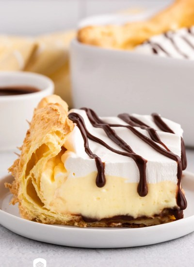 a slice of cream puff cake on a plate