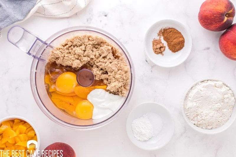 wet ingredients for peach bread in a food processor