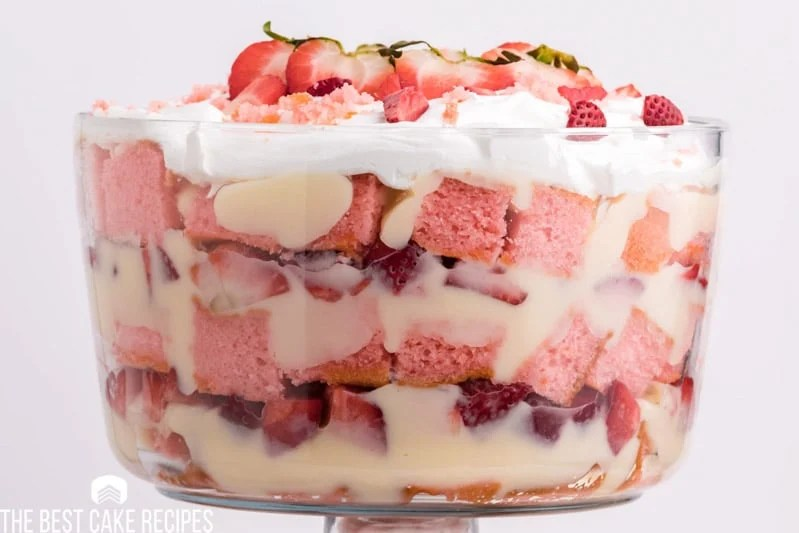 strawberry cheesecake trifle in a glass dish