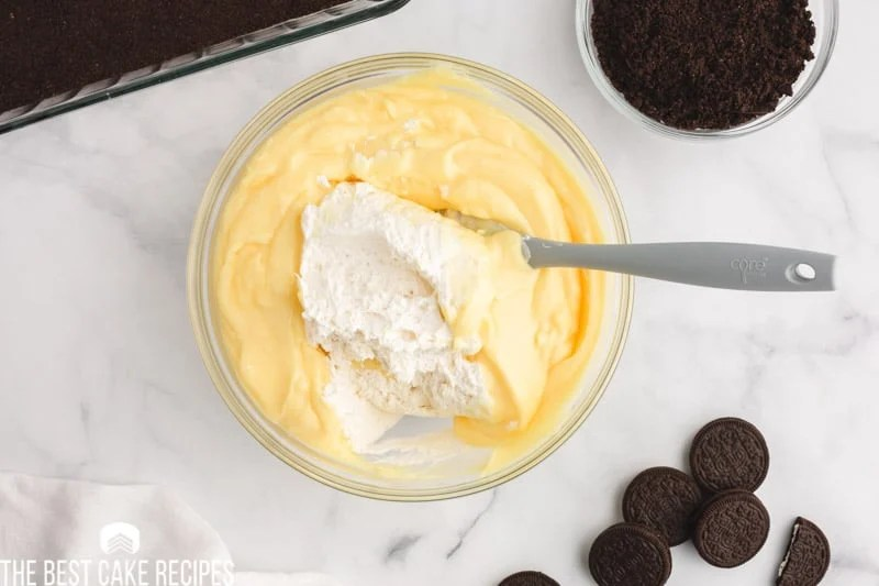 mixing whipped cream into pudding