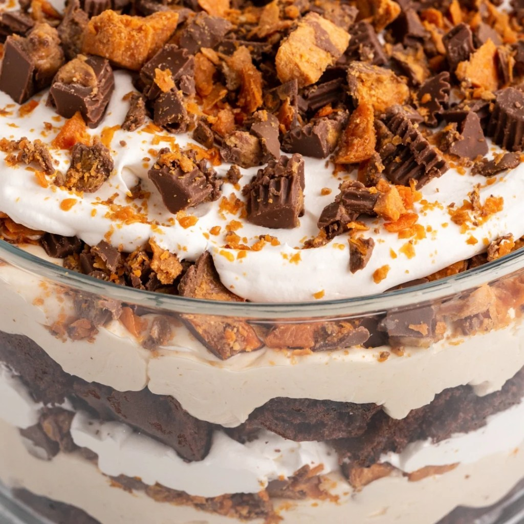 layered dessert with Reese's, Butterfinger and cake