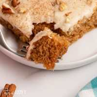 closeup of a piece of apple butter cake with a fork