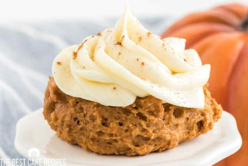 a closeup of a pumpkin cookie with frosting