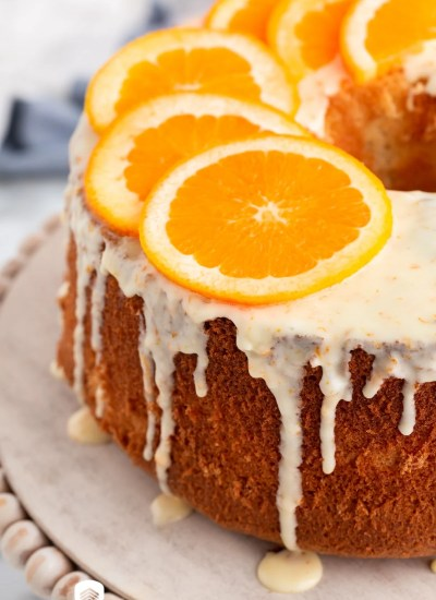 glaze dripping off a orange chiffon cake