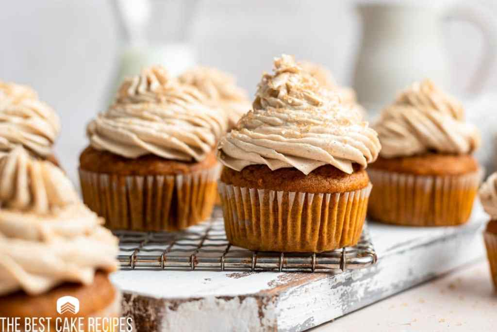 pumpkin spice latte cupcakes sitting on a table