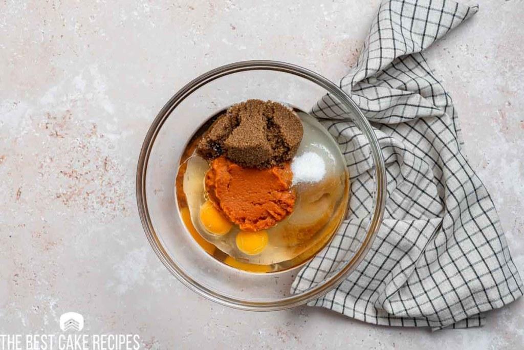 sugar, pumpkin and eggs in a mixing bowl