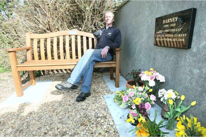 Sexton Alan Curzon sitting on the bench alongside the plaque in memory of Barney, the St Sampson's cemetery cat. (Picture by Adrian Miller, 14235848)