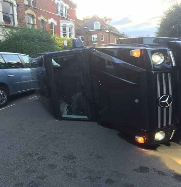 The Mercedes was pictured on its side (Picture: Twitter.com/JimHiggsy)