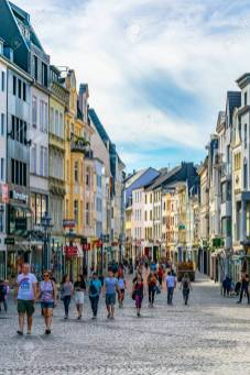 BONN, GERMANY, AUGUST 12, 2018: People passing a street in the c