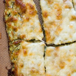 Try these Keto Cheesy Zucchini Breadsticks for a low carb appetizer or light lunch! At just 1.9 net carbs per breadstick this is a great low carb game day snack! #keto