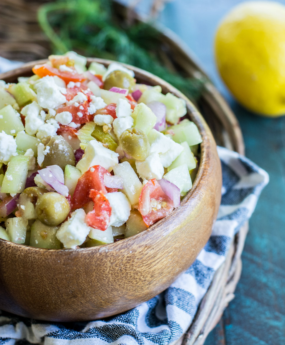 This Greek Cucumber Salad is packed with fresh vegetables and topped with tangy feta cheese! This is a great low carb lunch! #keto #lowcarb