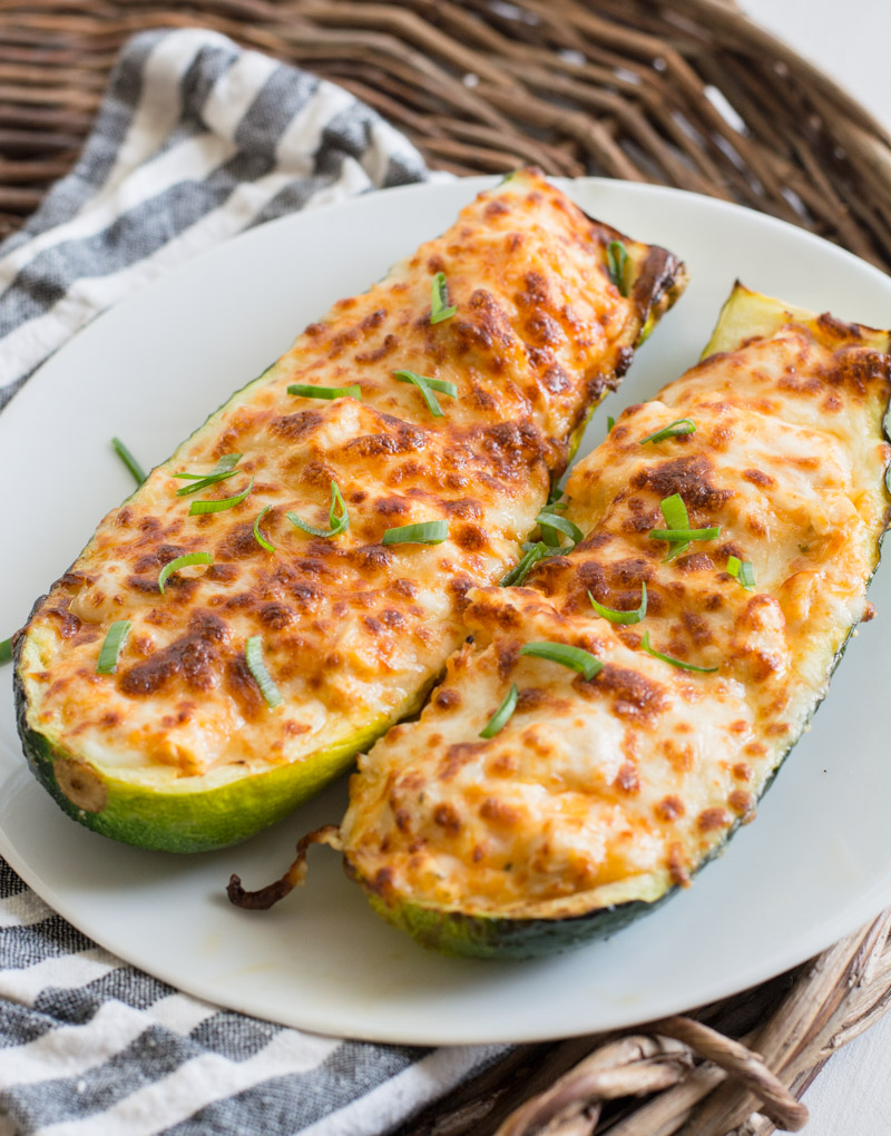 These easy Buffalo Chicken Zucchini Boats are loaded with chicken, cheese and spicy buffalo sauce! At only 4 net carbs per serving this will be your new favorite keto dinner!