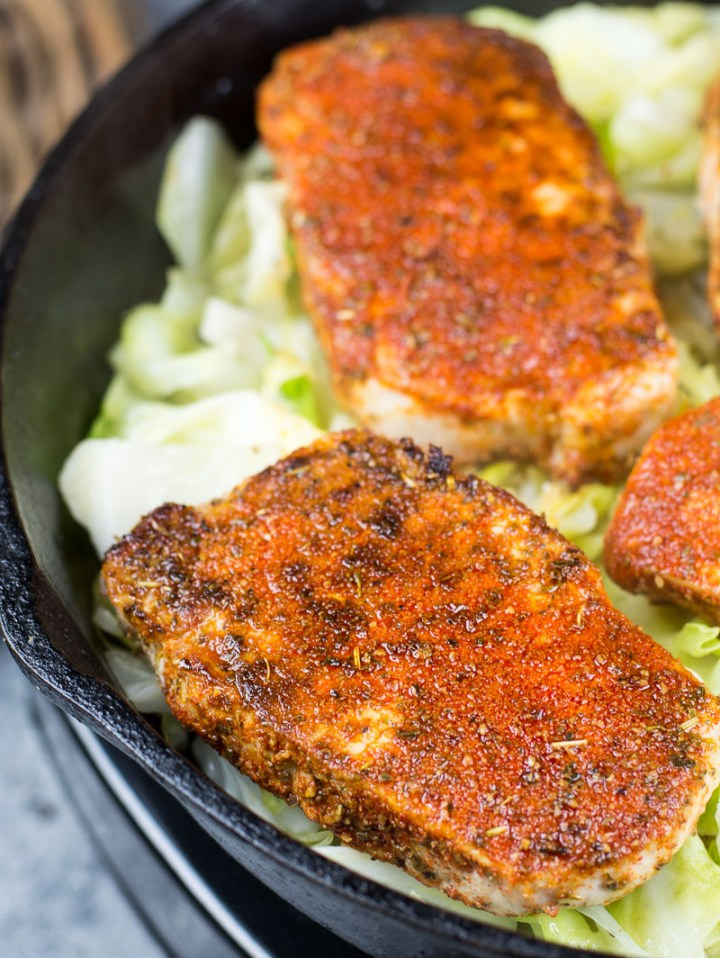 This easy Cajun Pork Chops and Fried Cabbage dish is the easiest one pan, 30 minute meal! At just 3.7 net carbs this is a low carb, keto approved dinner you will love! #keto