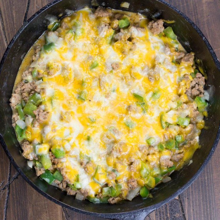 Try this easy One Pan Keto Philly Cheesesteak Skillet for an easy low carb dinner! This 20 minute meal is under 5 net carbs and loaded with ground beef, onions, peppers and cheese!