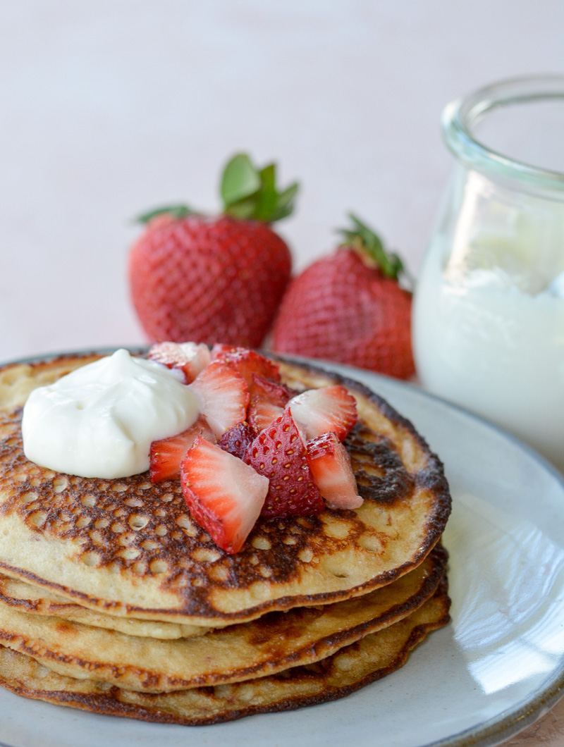 These Keto Strawberry Cream Cheese Pancakes are topped with a sweet vanilla cream cheese glaze! This easy keto breakfast recipe is about 2 net carbs per pancake and loaded with strawberry vanilla flavor!