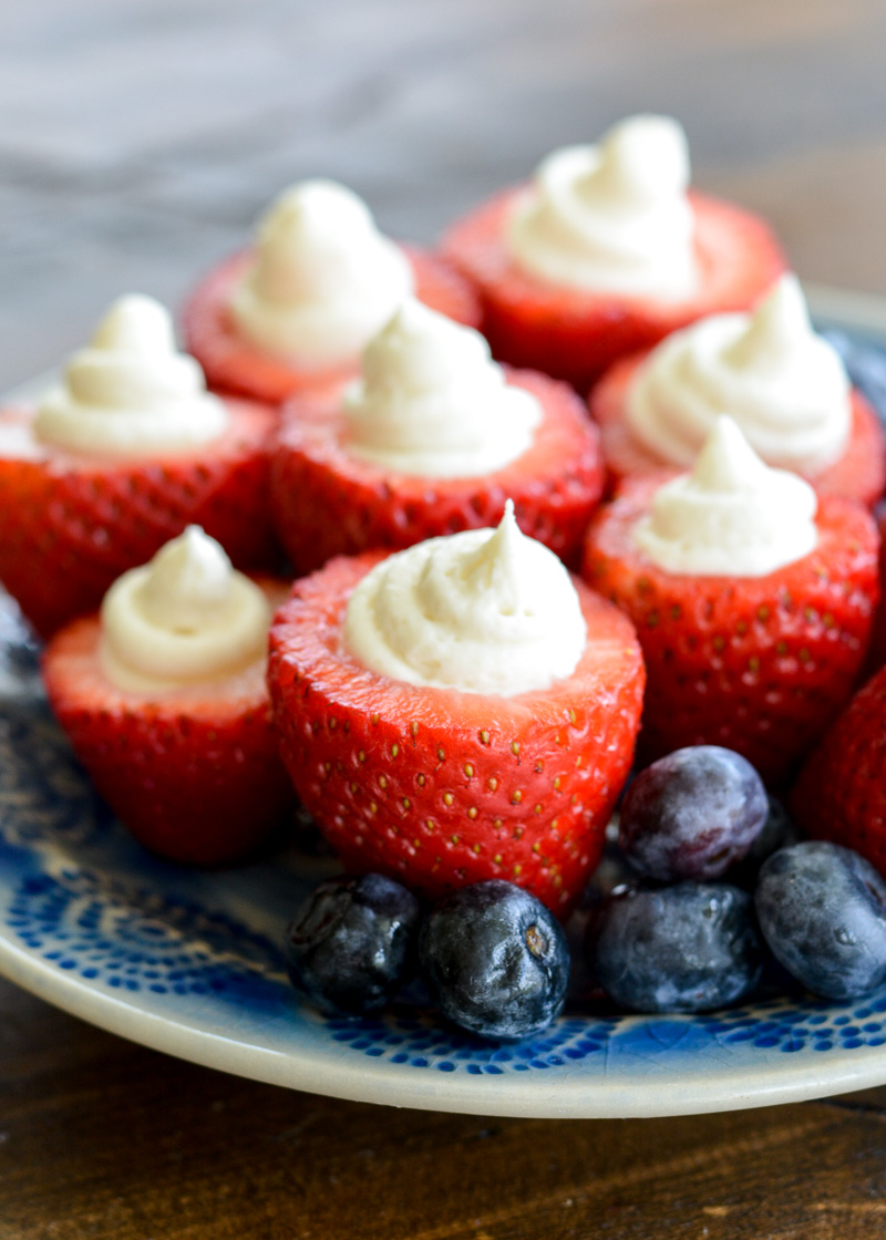 Simple no bake Keto Cheesecake Strawberries are the easiest low carb dessert! Enjoy four stuffed strawberries for about 5 net carbs!