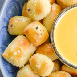 These soft Keto Pretzel Bites with Cheese Sauce are the perfect low carb appetizer! Enjoy 8 bites with cheese dip for less than 5 net carbs!